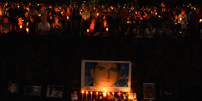 National lament: A shrine for Reza Berati during a candlelight vigil in support of asylum seekers in Brisbane, on February 23. The nation-wide vigil was held in response to the death of 23-year-old Iranian man Reza Berati who died while in a detention centre on Manus Island on February 18. Photo: AAP/Dan Peled