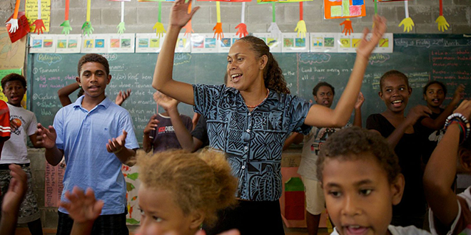Serious singing: Martina and her students sing the nursery rhymes that carry the messages that will help them stay safe during natural disasters. Photo: Richard Wainwright