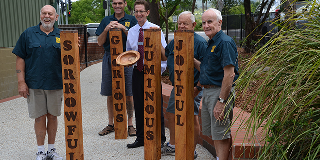 Joyful work: With Our Lady of the Rosary School principal Andrew Oberthur are Samford Area Men's Shed members (from left) Clive Botting, Alistair Sharp, Graham Macklin and Jim Loth.