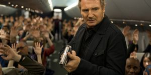 Flight drama: Liam Neeson (as air marshal Bill Marks) has to handle an in-flight drama in the movie Non-Stop; and (below) Jen Summers (Julianne Moore) and Marks. Photo: CNS/Universal