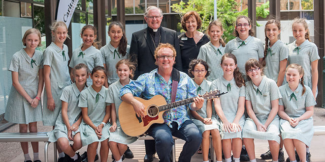 Music with heart: All Saints' Primary School choir with music teacher Ruth Skippen, musician and composer Michael Mangan, and Brisbane Archbishop Mark Coleridge. Photos: kissphotography