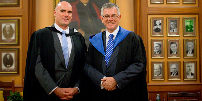 Ready to lead: St Leo's College's incoming leader Steve Foley with past rector Br Vince Skelly.