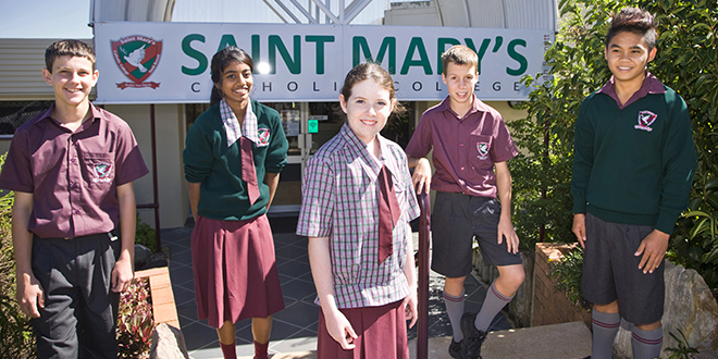 Dedicated history: St Mary's Catholic College students Jackson Langford, Pritika Sami, Grace McFarlane, Thomas Schmidhauser and Bao Truong in front of their beloved primary school.