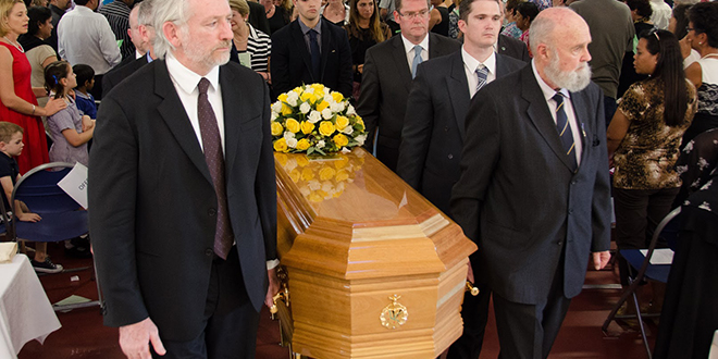 Brave Christian soul: Bishop Michael Putney's coffin is carried by pallbearers from his Funeral Mass on April 7.