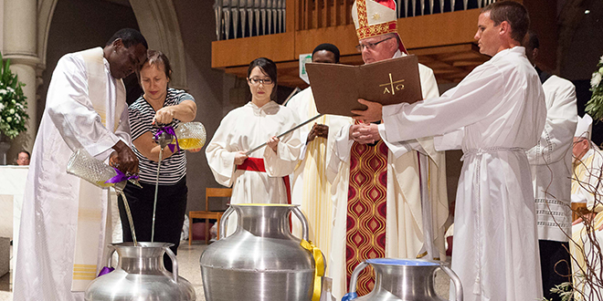 Holy oils: Brisbane Archbishop Mark Coleridge blesses the oils of the catechumens, oil of the sick and the chrism oil which will be administered in the sacraments of initiation, healing, and service at the chrism Mass at St Stephen's Cathedral. Photo: Alan Edgecomb