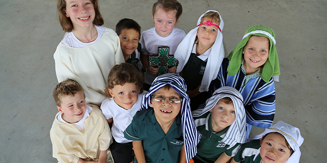 Easter joy: (Back row, from left, Edie Russell, Lewis Head, Eloise Gainer, Amaleas Weston, Maddie Howard, and front row, Archie Gwynne, Kathryn Atchinson, Ben Stallman, Angelo Halicos, Lana Nguyen share in the Easter joy at their Dutton park school.