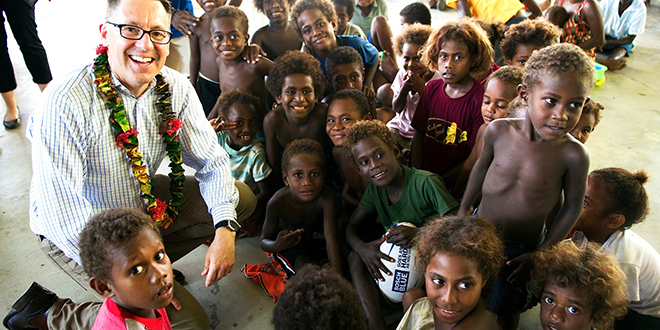 Helping hand: Queensland Senator Brett Mason visits children at the Don Bosco Technical Institute. The children have been displaced following two cyclones which brought heavy rain and flooding to many parts of the Solomon Islands. Photo: Erin Gleeson
