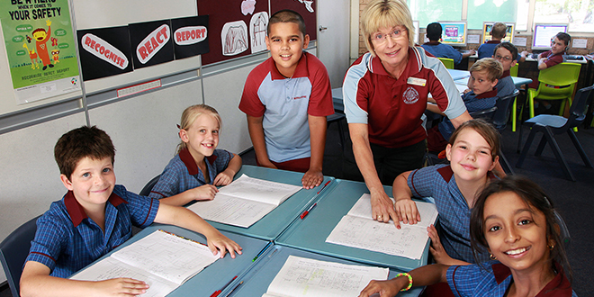 Learning: St Bernardine's students Jamie Anderson, Kyarni Badke, Jamaal Chaudhry, Ellie Woods and Sanjana D'Souza and teacher Rosie Jansen explore some of the resources available in the Daniel Morcombe Curriculum.