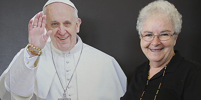Greetings: Sister Patricia Grundy of St Thomas More Catholic Parish with Pope Francis' cutout.