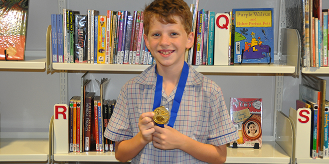 Little champion: Conor Dugan with his Under-10 State gold medal from the IGA State Championships in Cairns.