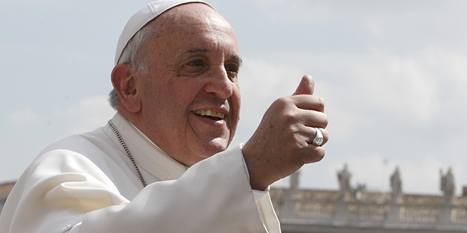 Pope Francis gives a thumbs up as he leaves his general audience in St. Peter's Square at the Vatican April 2. (CNS photo/Paul Haring)