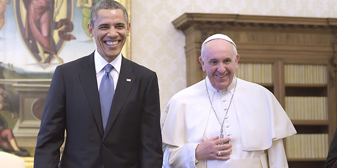 U.S. President Obama walks with Pope Francis during private audience at Vatican