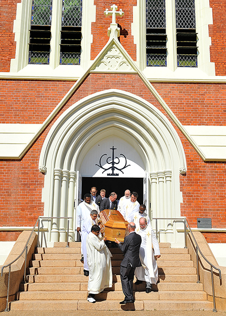 Farewell: Bishop Michael Putney's coffin is carried by pallbearers from Sacred Heart Cathedral. Photo: Townsville Bulletin
