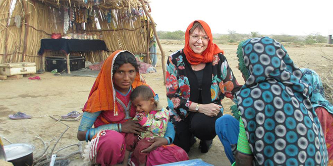 Reaching out: Rowena McNally meeting people in the Pakistan village of Jhirruk where St Elizabeth's Hospital delivers mobile medical services.