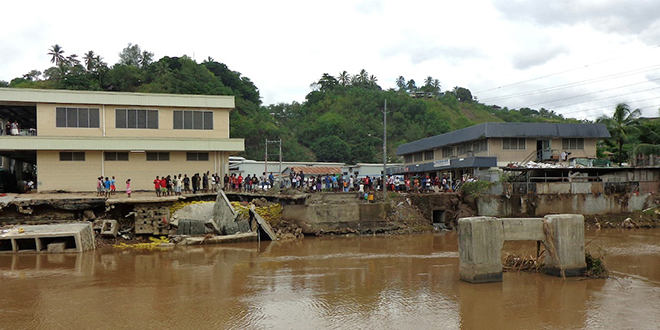 Danger zone: Damage to buildings and infrastructure along the banks of Honiara's Matanikau River, which burst its banks during recent torrential rain from two cyclones.