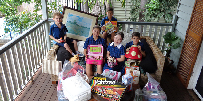 Treasured items: Christ the King school students Toby Forbes, Ruth Forbes, Dominic Forbes, Chelsea Throssell and Archie Forbes with donations for Christ the King school's mega garage sale.
