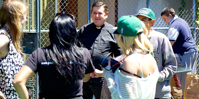 Reaching out: Fr Chris Riley connecting with young people in the Youth Off The Streets team.