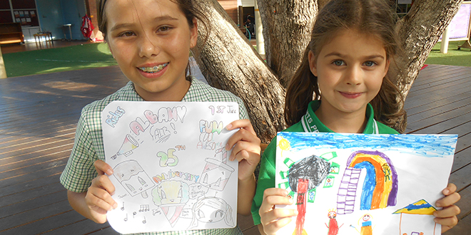 Fair excitement: All Saints' School's Year 6 student Tayliah Tam and Prep student Charlotte Jahke show off their poster entries for the Albany Fair.
