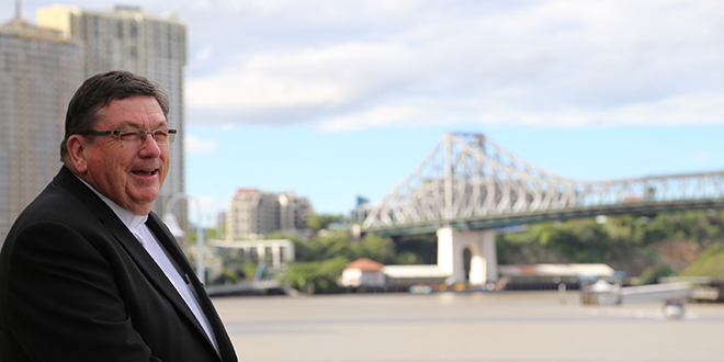 New horizons: Bishop-elect Michael McCarthy takes in the view overlooking the Brisbane River one last time before heading to Rockhampton for his episcopal ordination.