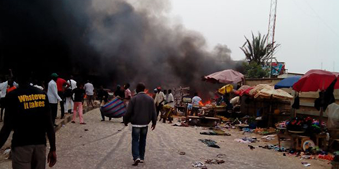 Time for action: Smoke rises after a bomb blast at the market district in Jos, Nigeria, on May 20. Back-to-back bombings killed at least 118 people and wounded 45 in the crowded business district of the central Nigerian city, the National Emergency Management Agency reported, in an attack that appeared to bear the hallmarks of Boko Haram insurgents. Photo: CNS/Reuters