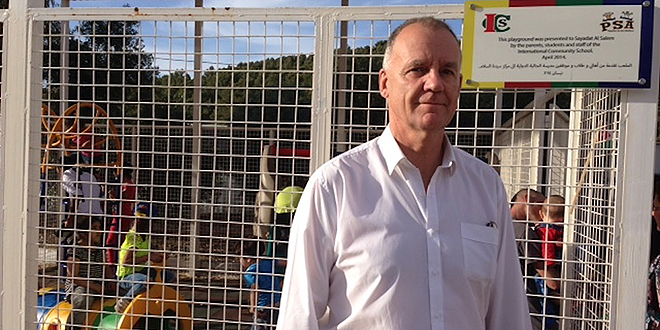 Charity abroad: Paul O'Callaghan outside a Catholic centre caring for 400 Syrian refugee families in Amman. Jordan. He recently visited the centre on behalf of Caritas Australia while on a pilgrimage with 20 leaders of the Caritas Internationalis network to the Holy Land.