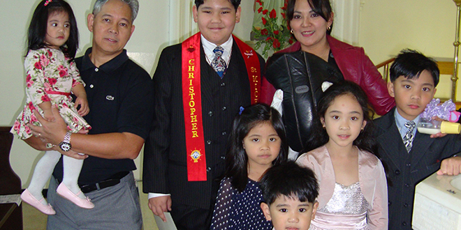 Celebrating confirmation: Christopher Mateo (centre) with his family (from left) Pauline, father Lito, mum Cyndee with baby sister Leonie, and younger siblings Celine, Max, Therese and Joseph.