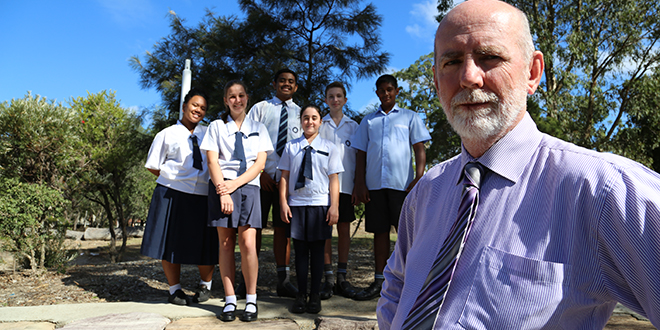Franciscan roots: Bubba Tou, Kasey Seawright, Damian Lam Sam, Kaitlyn Lake, Joshua Francillon and Shiv Singh with the head of campus Mark Fogarty.