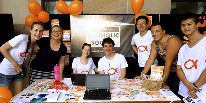 Evangelising: Members of the University of Queensland Newman Society sharing the faith.