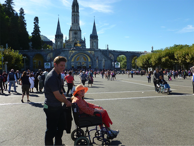 Fellow pilgrim Samuel Letteri of Sydney pushing Amelia through Lourdes where her health declined and she was in a wheelchair for three days.
