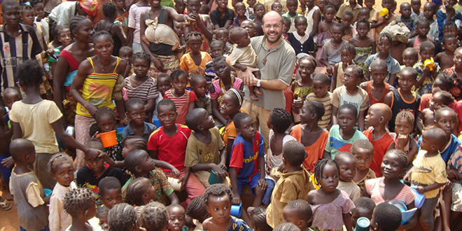 Mission grounds: The prior of the Carmelite Monastery in Bangui, Fr Federico Trinchero with some of the thousands of refugees seeking shelter in the monastery's compound. Photo: Aid to the Church in Need