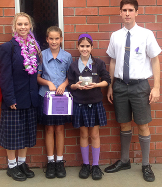 School support: St Eugene College Burpengary students Maddison Alcock, Tanika Grinsill, Chelsea Prince and Ryan Prince after the purple-themed fundraising day to help Miranda Crawley