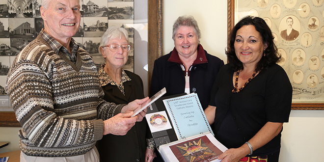 Legacy of faith: At the handover of Murri Ministry's project on Aboriginal Catholic history in Cherbourg and Stradbroke Island are (from left) Fr Denis Martin, Josephite Sister Kay McPadden, Mercy Sister Mary Lowcock and Ravina Waldren.