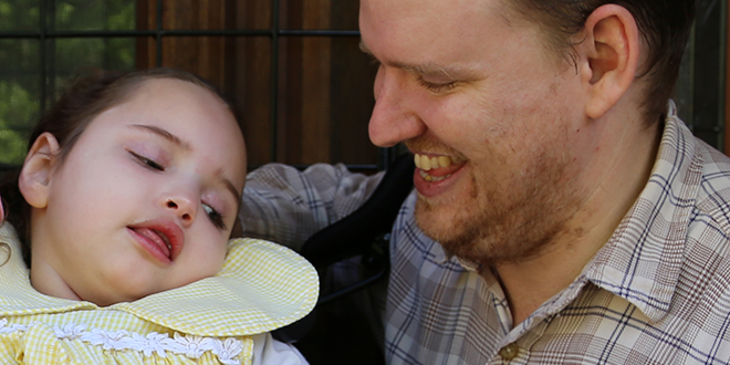 Latest miracle: Gabby Caldwell with her loving dad Kevin Caldwell. Photo: Emilie Ng