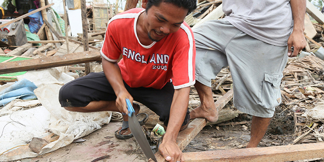 Grateful for help: Reconstruction work continues in the Philippines with help from Caritas after last year's devastating Cyclone Haiyan.