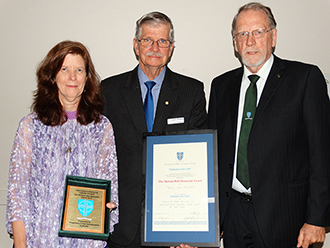 International recognition: Patti Camp receives the Michael Bell Memorial Award on behalf of Pregnancy Crisis Incorporated. With her are David Jefferies (centre) and David Huppatz.