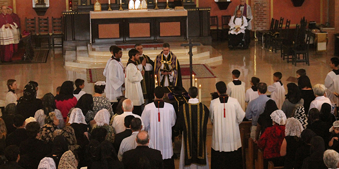 Vale: Superior of the Priestly Fraternity of St Peter religious order in North America Fr Eric Flood reads over the coffin of Fr Kenneth Walker during his funeral Mass on June 16 at St Catherine of Siena Church in Phoenix. Photo: CNS/Joyce Coronel, The Catholic Sun