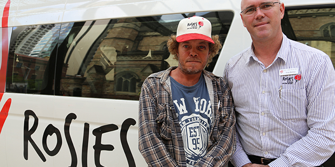 Hand up: Rosies manager Troy Bailey (right) with homeless man Karl Stuart. Both men say Rosies is an important support for people who fall on hard times. Photos: Paul Dobbyn