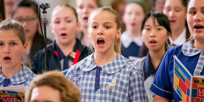 Voice of praise: Members of the choir at the Catholic Education Week Mass in St Stephen's Cathedral, Brisbane, last Sunday.