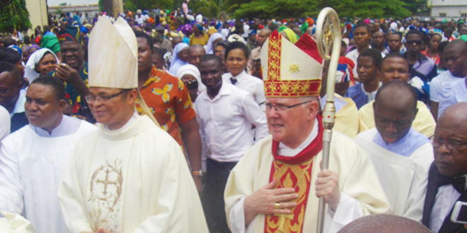 Bishop Lucius Ugorji and Archbishop Mark Coleridge process through the crowd after the Mass in Mater Dei Cathedral, Umuahia, for the ordination of 10 men.
