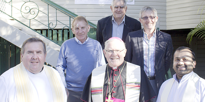 Assisting families: Noosa District Catholic parish priest Fr Mark Franklin, president of the St Vincent de Paul Society's Noosa conference Larry McErvale, Archbishop Mark Coleridge, Noosa Parish Life and Faith Council chair Denis Meadows, Parish Finance Council chair John Harrison, and assistant priest Fr Jojimon Thomas at the blessing and opening of Assisi House, Tewantin.