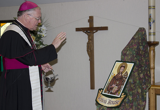 Blessing: Archbishop Coleridge blesses Assisi House.
