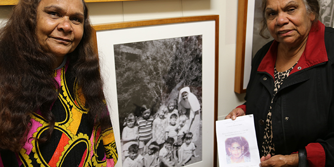 Priceless treasure: Aunty Melita Orcher (right) holds a funeral booklet bearing the image of her beloved daughter-in-law Lizzie Smith. Also pictured is her sister Aunty Estelle Sandow. In the background is a photograph of Aunty Melita's daughter-in-law as a young girl(front row with a hand above her eyes).