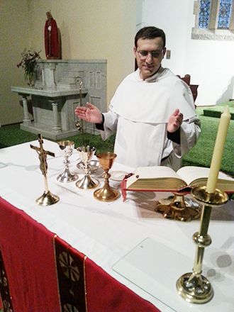 Preparing for ordination: Dominican Brother Thomas Azzi at the altar practising the rubrics of the Mass.