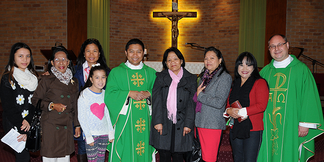 Nerang visit: Fr Bing Monteagudo (fifth from left) and his mother Cilvia Andrson (sixth from left) are with Fr Rafal Rucinski and members of the Filipino community of St Brigid's Parish, Nerang. Photo: Robin Williams