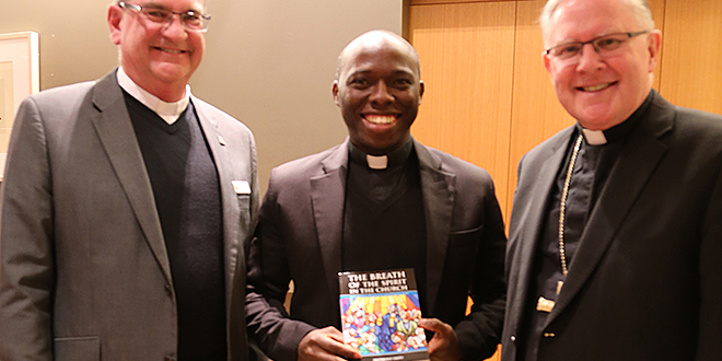 Archdiocesan launch: Dean of St Stephen's Cathedral Fr David Pascoe (left) with Fr Anthony Ekpo (centre) and Archbishop Mark Coleridge at the book launch on July 10.