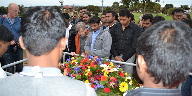 Sad farewell: Mourners pray at the grave of Leo Seemanpillai who died on May 31.