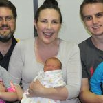 Welcoming number four: The Blom family (back from left) Paul, Libby and Zachary; and (front) Anastasia, Magdalen and Lawrence.