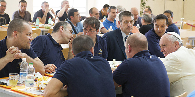 Lunch with Pope: Pope Francis talks with Vatican workers during a surprise visit to the Vatican cafeteria on July 25. Photo: CNS/L'Osservatore Romano via Reuters