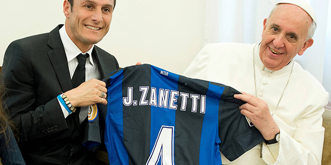 """Game on: Pope Francis receives a soccer jersey from Inter Milan captain Javier Zanetti during a private audience at the Vatican on April 25 last year. Following from that meeting the """"Inter-religious Match for Peace"""" has been organised for September 1 in Rome. Photo: CNS/L'Ossevatore Romano via Reuters"""