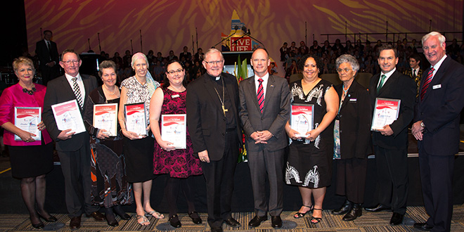 Special guests: Brisbane Archbishop Mark Coleridge (sixth from left), Premier Campbell Newman (seventh from left); Aunty Joan Hendriks (ninth from left) and Queensland Catholic Education Commission executive director Mike Byrne (right) are with Spirit of Catholic Education Award recipients for 2014 (from left) Elizabeth Poulton, from Sacred Heart Primary School, Toowoomba; Brian O'Reilly, from St Joseph's Nudgee College, Brisbane; Bernadette Mitchell, from The Cathedral College, Rockhampton; Kim Bellert, from Diocese of Townsville; Rebecca McGregor, from St Peter's Catholic Primary School, Caboolture; Pelly Morganson, from St Teresa's College, Abergowrie; and Gavin Rick, from St Joseph's School, Parramatta Park, Cairns.